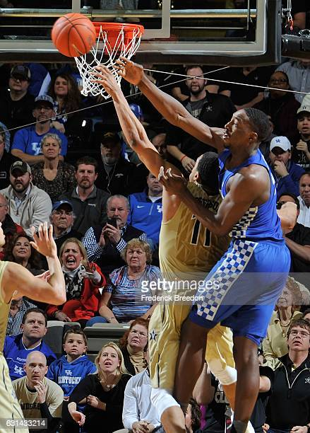 Jeff Roberson of the Vanderbilt Commodores jumps for a shot against Isaiah Briscoe of the Kentucky Wildcats during the second half at Memorial Gym on...