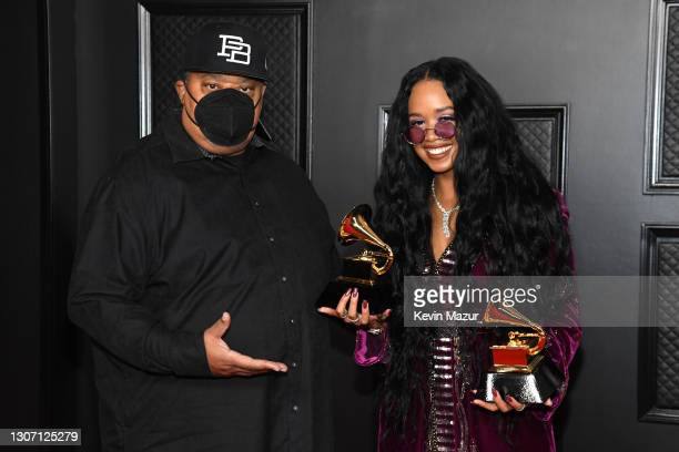 """Jeff Robinson and H.E.R., winners of Song of the Year for """"I Can't Breathe"""", pose in the media room during the 63rd Annual GRAMMY Awards at Los..."""