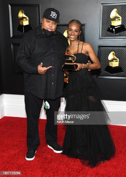 """Jeff Robinson and Tiara Thomas, winners of Song of the Year for """"I Can't Breathe"""", pose in the media room during the 63rd Annual GRAMMY Awards at Los..."""