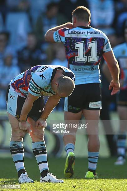 Jeff Robson and Chris Heighington of the Sharks look dejected after defeat the round 24 NRL match between the Cronulla Sharks and the Canberra...