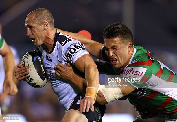 Jeff Robson of the Sharks is tackled by Sam Burgess during the round 11 NRL match between the Cronulla-Sutherland Sharks and the South Sydney...