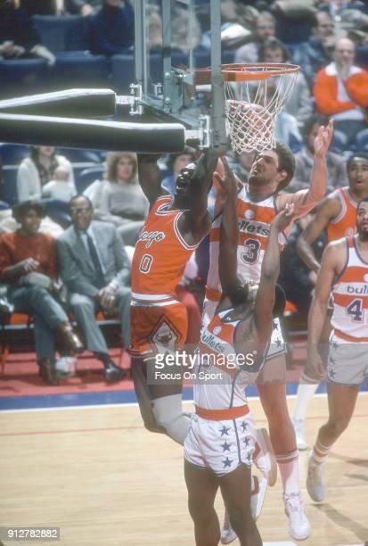 Jeff Ruland of the Washington Bullets blocks the shot of Orlando Woolridge of the Chicago Bulls during an NBA basketball game circa 1982 at the...