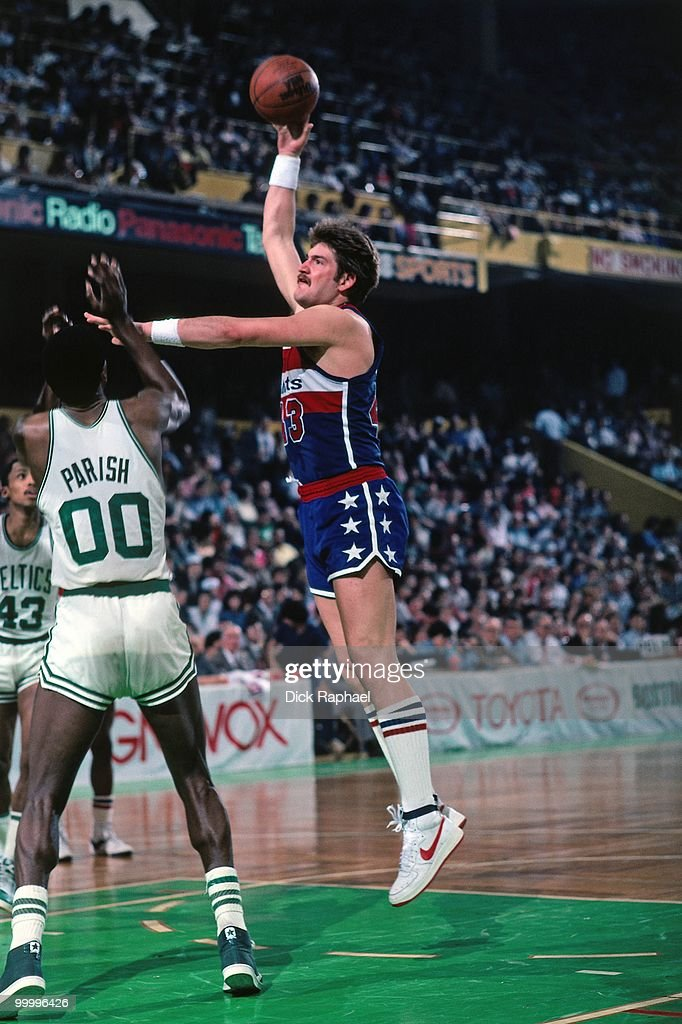 Jeff Ruland #43 of the Washington Bullets goes up for a shot against Robert Parish #00 of the Boston Celtics during a game played in 1983 at the Boston Garden in Boston, Massachusetts.
