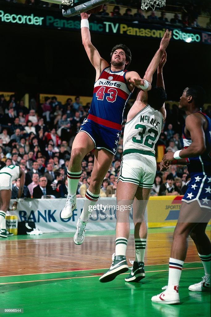 Jeff Ruland #43 of the Washington Bullets shoots against Kevin McHale #32 of the Boston Celtics during a game played in 1983 at the Boston Garden in Boston, Massachusetts.