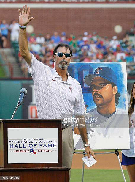 Jeff Russell 2015 Texas Rangers Baseball Hall of Fame inductee waves to the crowd at an induction ceremony at Globe Life Park in Arlington Texas on...