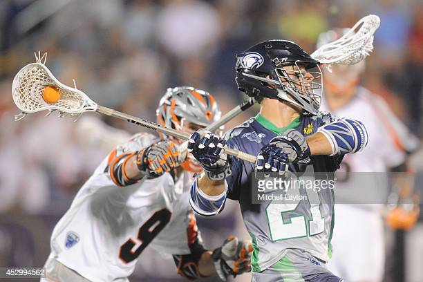 Jeff Ryenolds of the Chesapeake Bayhawks puts pressure on Cam Holding of the Denver Outlaws during a MLL lacrosse game on July 31 2014 at NavyMarine...
