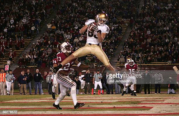 Jeff Samardzija of the Notre Dame catches a touchdown over Brandon Harrison of Stanford on November 26 2005 at Stanford Stadium in Palo Alto...