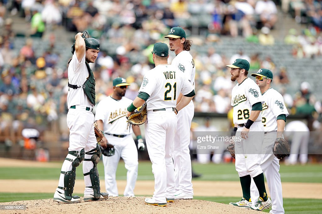 Jeff Samardzija #29 of the Oakland Athletics waits with the infielders for manager Bob Melvin to take him out of the game in the inning of their game against the New York Mets at O.co Coliseum on August 20, 2014 in Oakland, California.