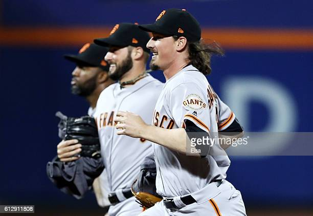 Jeff Samardzija of the San Francisco Giants celebrates with teammates after they defeated the New York Mets 30 to win the National League Wild Card...
