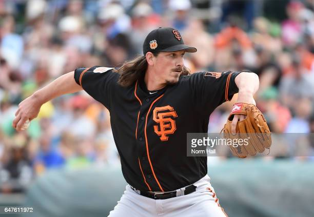 Jeff Samardzija of the San Francisco Giants delivers a first inning pitch of a spring training game against the Oakland Athletics at HoHoKam Stadium...