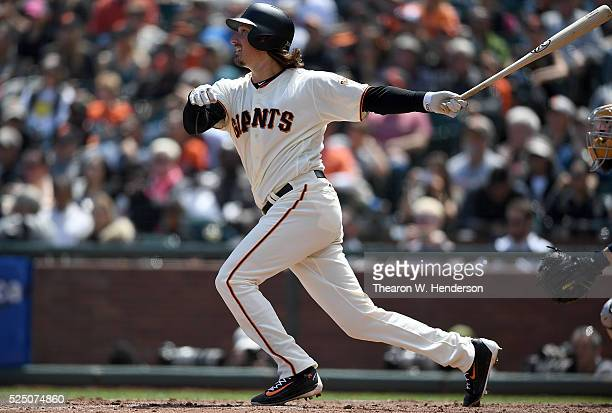 Jeff Samardzija of the San Francisco Giants hits a bases loaded two run rbi single against the San Diego Padres in the bottom of the third inning at...
