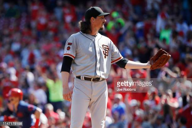 Jeff Samardzija of the San Francisco Giants reacts after giving up a third straight home run to the Cincinnati Reds in the first inning at Great...