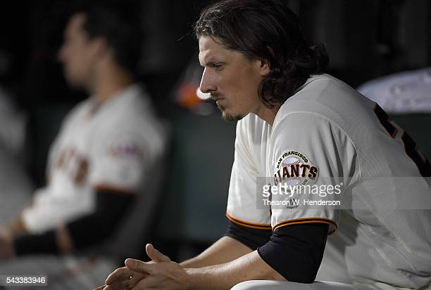 Jeff Samardzija of the San Francisco Giants sits in the dugout after he was taken out of the game against the Oakland Athletics in the bottom of the...