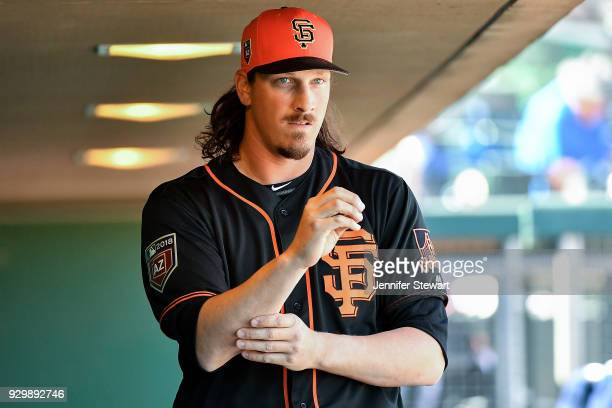 Jeff Samardzija of the San Francisco Giants walks through the dugout prior to the spring training game against the Seattle Mariners at Scottsdale...