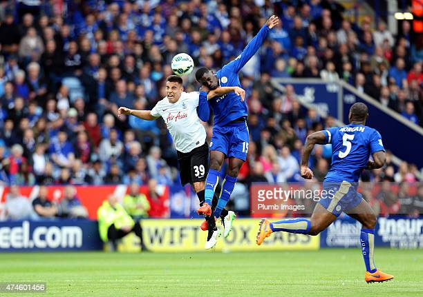Jeff Schlupp of Leicester City in action with Reece GregoCox of QPR during the Barclays Premier League match between Leicester City and Queens Park...