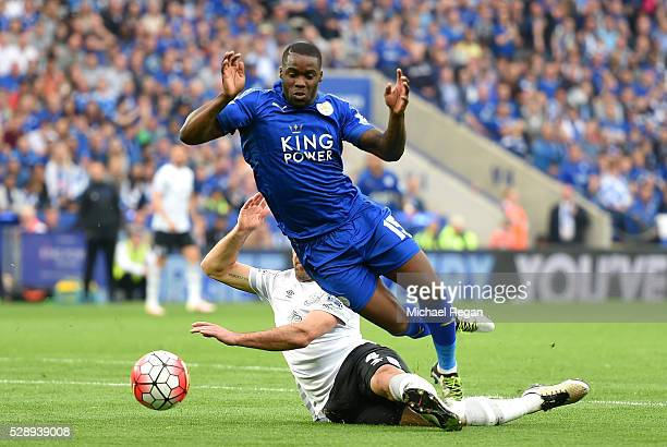 Jeff Schlupp of Leicester City is fouled by Darron Gibson of Everton resulting in a penalty kick during the Barclays Premier League match between...