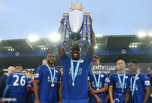Jeff Schlupp of Leicester City lifts the Premier League Trophy as players and staffs celebrate the season champions after the Barclays Premier League...