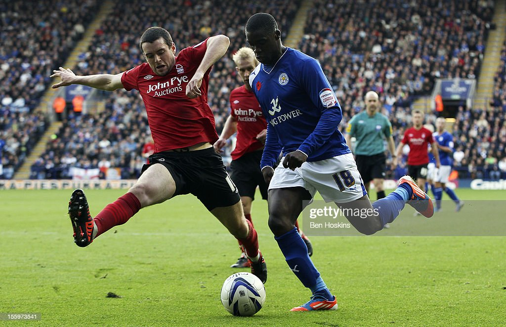 Jeff Schlupp of Leicester is put under pressure by Brendan Moloney of Nottingham during the npower Championship match between Leicester City and Nottingham Forest at the King Power Stadium on November 10, 2012 in Leicester, England.
