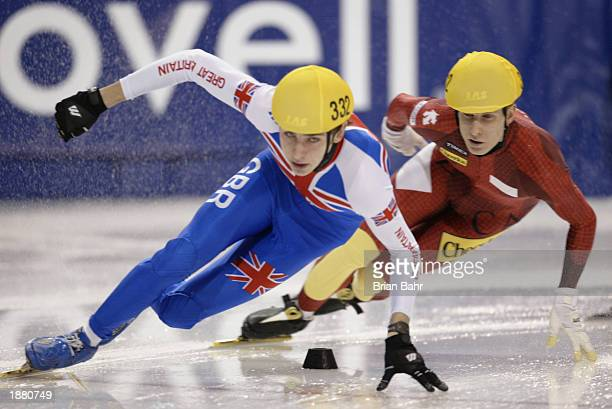 Jeff Scholten of Canada drafts behind John Eley of Great Britain during the mens 1000 meter heats of the ISU Short Track Speedskating World Cup...