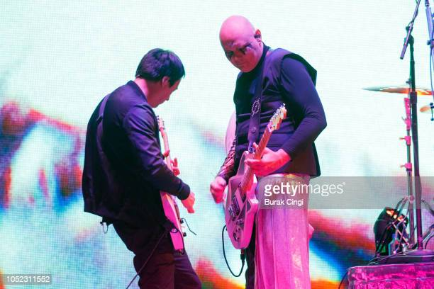 Jeff Schroeder and Billy Corgan of Smashing Pumpkins perform on stage at The SSE Arena Wembley on October 16, 2018 in London, England.