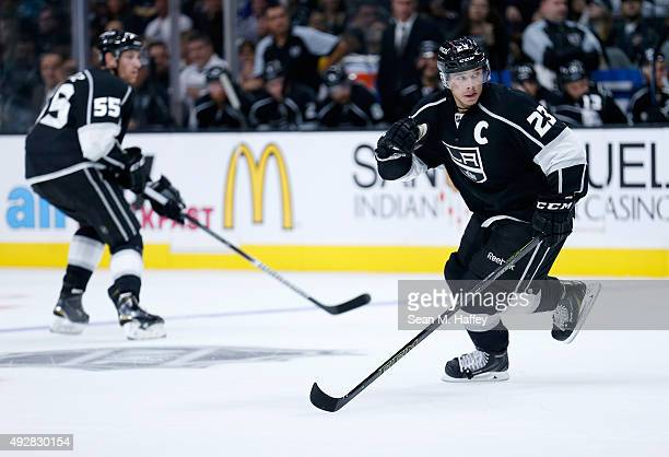Jeff Schultz of the Los Angeles Kings and Dustin Brown of the Los Angeles Kings skate during a game agains the San Jose Sharks at Staples Center on...