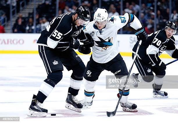 Jeff Schultz of the Los Angeles Kings and Tanner Pearson of the Los Angeles Kings skates against Tommy Wingels of the San Jose Sharks during a game...
