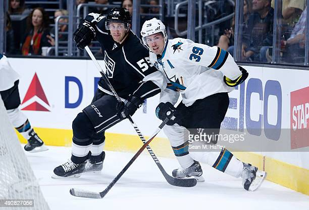 Jeff Schultz of the Los Angeles Kings battles with Logan Couture of the San Jose Sharks during a game at Staples Center on October 7 2015 in Los...