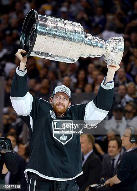 Jeff Schultz of the Los Angeles Kings celebrates with the Stanley Cup after the Kings 32 double overtime victory against the New York Rangers in Game...