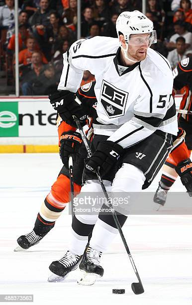 Jeff Schultz of the Los Angeles Kings handles the puck against the Anaheim Ducks in the Second Round of the 2014 Stanley Cup Playoffs at Honda Center...