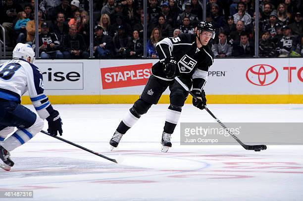 Jeff Schultz of the Los Angeles Kings handles the puck during a game against the Winnipeg Jets at STAPLES Center on January 10 2015 in Los Angeles...