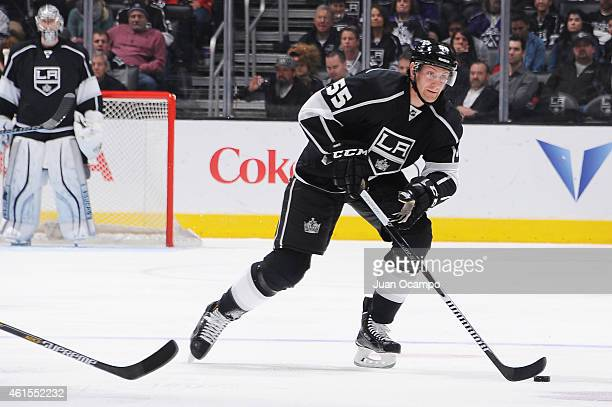Jeff Schultz of the Los Angeles Kings handles the puck during a game against the New Jersey Devils at STAPLES Center on January 14 2015 in Los...