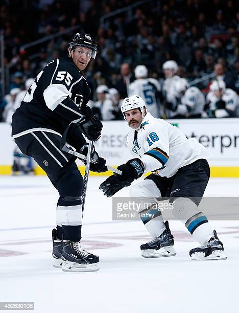 Jeff Schultz of the Los Angeles Kings skates against Mike Brown of the San Jose Sharks during a game at Staples Center on October 7 2015 in Los...