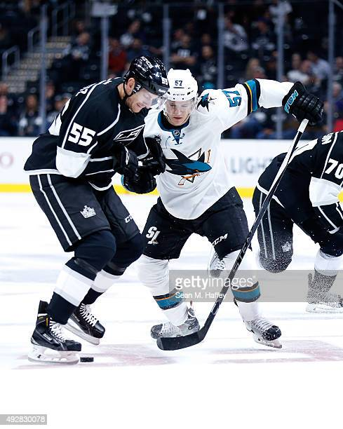 Jeff Schultz of the Los Angeles Kings skates against Tommy Wingels of the San Jose Sharks during a game at Staples Center on October 7 2015 in Los...