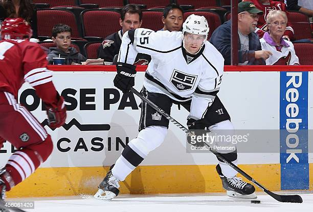 Jeff Schultz of the Los Angeles Kings skates with the puck during the preseason NHL game against the Arizona Coyotes at Gila River Arena on September...