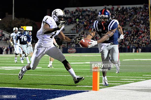 Jeff Scott of the Ole Miss Rebels reaches for the end zone in front of Kenny Ladler of the Vanderbilt Commodores during a game at VaughtHemingway...