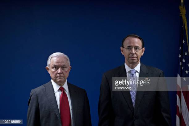 Jeff Sessions US attorney general left and Rod Rosenstein deputy attorney general stand during a news conference at the US Attorney's Office for the...