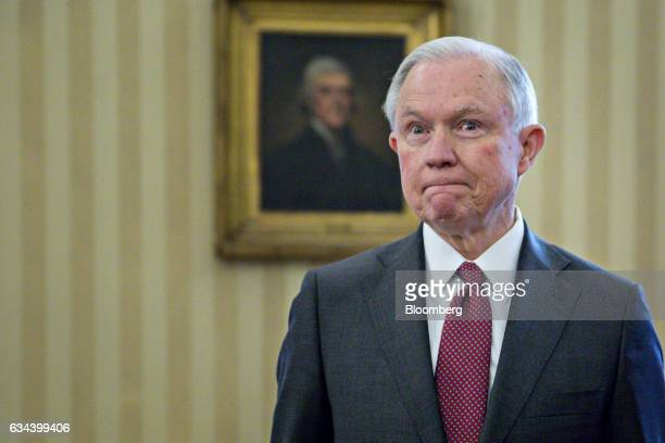 Jeff Sessions US attorney general pauses after being sworn in by US Vice President Mike Pence not pictured in the Oval Office of the White House in...