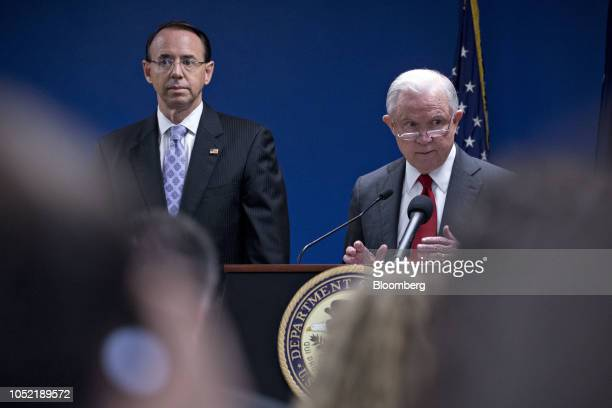 Jeff Sessions US attorney general speaks as Rod Rosenstein deputy attorney general left listens during a news conference at the US Attorney's Office...