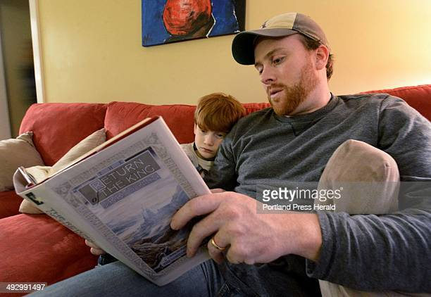 Jeff Shaw reads The Return of the King by J R R Tolkien with his son Brayden 7 at their Portland home Monday December 10 2012