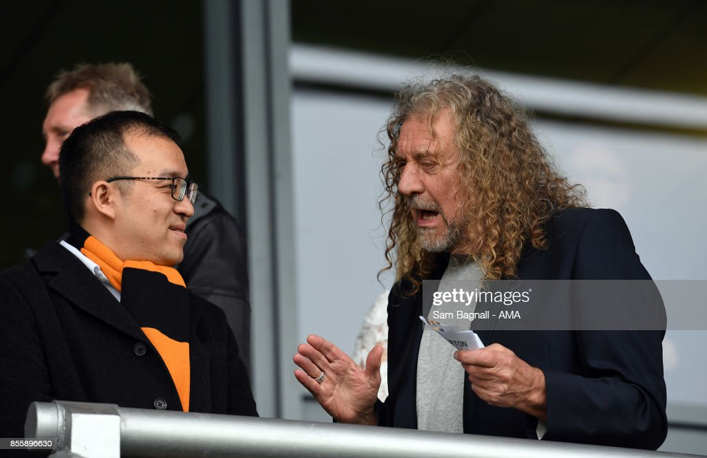 Jeff Shi of Fosun and Wolverhampton Wanderers speaks with Robert Plant during the Sky Bet Championship match between Burton Albion and Wolverhampton at Pirelli Stadium on September 30, 2017 in Burton-upon-Trent, England.