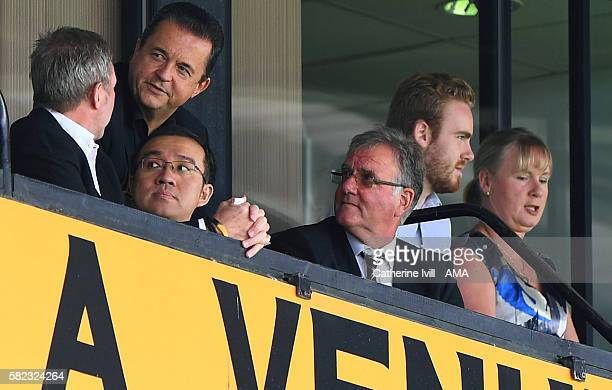 Jeff Shi representative of Fosun Group with Jez Moxey CEO of Wolverhampton Wanderers and director John Gough during the PreSeason Friendly match...