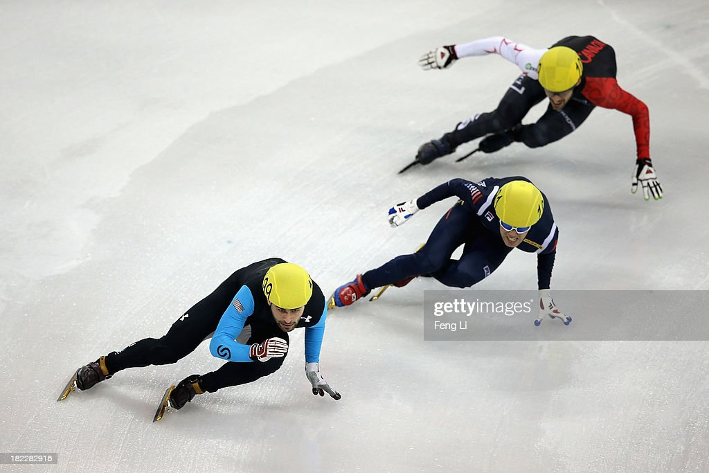 Jeff Simon of United States (Left) competes in the Men's 5000m Relay Final during day four of the Samsung ISU World Cup Short Track at the Oriental Sports Center on September 29, 2013 in Shanghai, China.