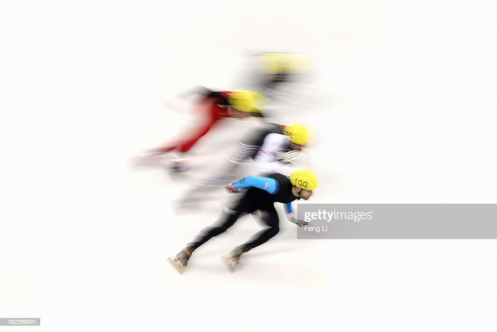 Jeff Simon of United States (Front) competes in the Men's 5000m Relay Final during day four of the Samsung ISU World Cup Short Track at the Oriental Sports Center on September 29, 2013 in Shanghai, China.