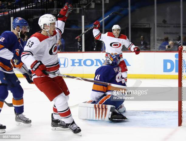 Jeff Skinner and Derek Ryan of the Carolina Hurricanes celebrate a first period goal by Lee Stempniak against Jaroslav Halak of the New York...
