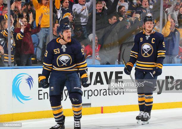 Jeff Skinner celebrates his third period goal with Jack Eichel of the Buffalo Sabres during an NHL game against the Montreal Canadiens on November 23...