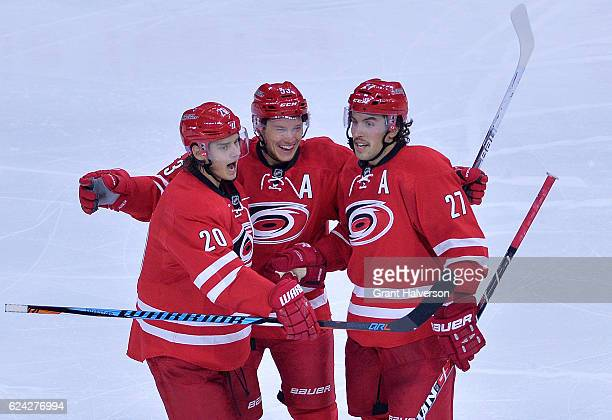 Jeff Skinner celebrates with teammates Sebastian Aho and Justin Faulk of the Carolina Hurricanes after scoring a goal against the Montreal Canadiens...