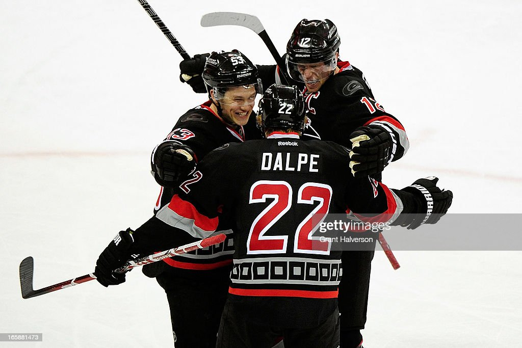 Jeff Skinner #53, Eric Staal #12 and Zac Dalpe #22 of the Carolina Hurricanes celebrate after Dalpe's goal against of the New York Rangers during the third period at PNC Arena on April 6, 2013 in Raleigh, North Carolina. The Rangers won 4-1.