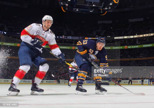 Jeff Skinner of the Buffalo Sabres and Juho Lammikko of the Florida Panthers follow the play during an NHL game on January 3, 2019 at KeyBank Center...