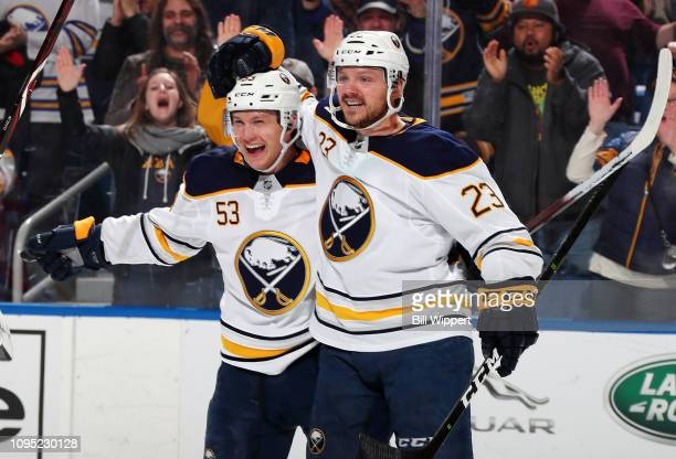 Jeff Skinner of the Buffalo Sabres celebrates his second goal of the game with Sam Reinhart during an NHL game against the Carolina Hurricanes on...