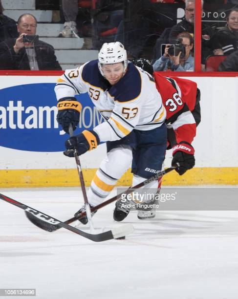 Jeff Skinner of the Buffalo Sabres controls the puck against Colin White of the Ottawa Senators at Canadian Tire Centre on November 1 2018 in Ottawa...